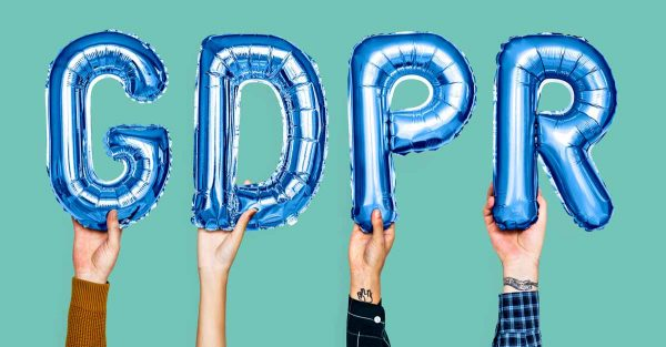 Hands with balloon letters - GDPR